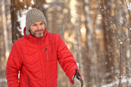 crosscountry: Mature man in red jacket cross-country skiing