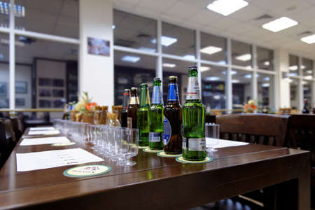 carlsberg: St. Petersburg, Russia - October 24, 2015: Beer bottles at the table during tasting session in the Baltika - St Petersburg brewery. This session is a part of the October Beer Festival celebrations