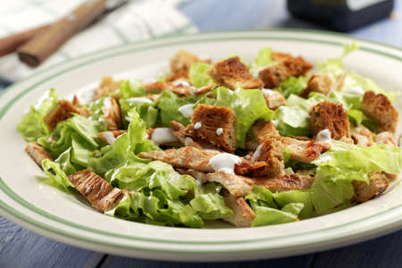 chicken caesar salad: Caesar salad with lettuce, croutons, turkey meat, and mayonnaise Stock Photo