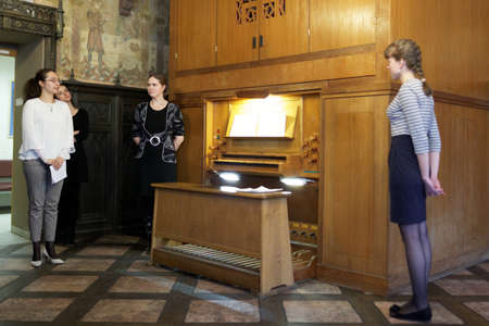 pipe organ: St. Petersburg, Russia - November 14, 2015: Staff of the department of organ, harpsichord, and carillon of Saint-Petersburg University at the pipe organ during the meeting Bell and Carillon Art in Russia