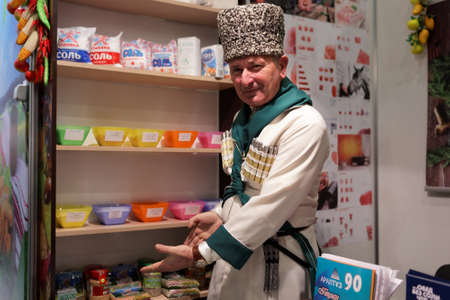 manufacturers: St. Petersburg, Russia - November 18, 2015: Vendor presenting salts and spices in the food exhibition PeterFood. The exhibition is setting up contacts between food manufacturers and retail networks Editorial