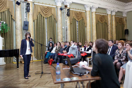 st german: St. Petersburg, Russia - November 21, 2015: Deputy director of the Goethe-Institut in Saint-Petersburg Angela Noke delivers the opening remarks during the Day of German teachers in the Anichkov palace