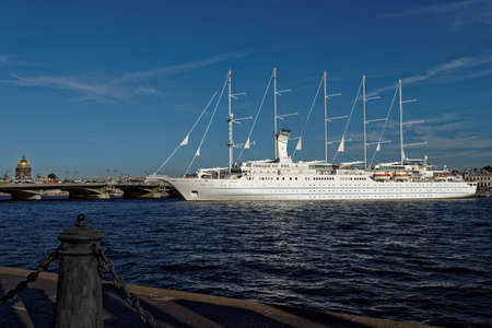 cruise liner: St. Petersburg, Russia - August 5, 2015: Cruise liner Wind Surf of Windstar Cruises Luxury Lines departs from the Neva river. The 5-masts ship provides luxury cruise for 310 guests Editorial