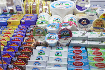 business exhibition: St. Petersburg, Russia - November 18, 2015: Dairy products in the International food exhibition PeterFood. The exhibition is setting up contacts between food manufacturers and retail networks
