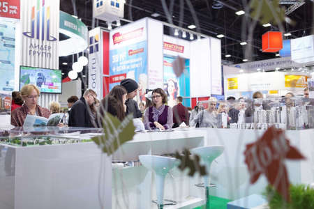 october 31: St. Petersburg, Russia - October 31, 2015: Visitors in the Expoforum during the Real Estate Fair. It is the largest real estate exhibition in Russia, presenting urban and suburban property