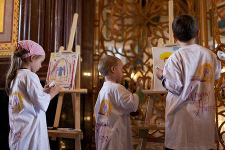 Moscow, Russia - November 27, 2015: Talented children from large families draw their guardian angel during the annual action Angel Wings in the Cathedral of Christ the Savior