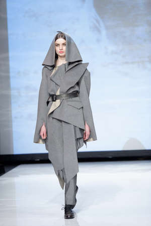 sums: St. Petersburg, Russia - December 5, 2015: Collection of fashion house Harlen at the fashion show during St. Petersburg Fashion Week Overview. The event sums up the year of the city's fashion industry