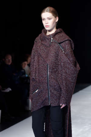 sums: St. Petersburg, Russia - December 5, 2015: Collection of fashion house Harlen at the fashion show during St. Petersburg Fashion Week Overview. The event sums up the year of the citys fashion industry