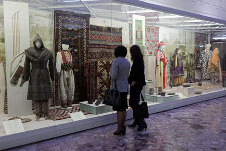 ethnography: St. Petersburg, Russia - December 14, 2015: Women watching the exposition in the Russian Museum of Ethnography during 4th St. Petersburg International Cultural Forum. Business venues events were held here