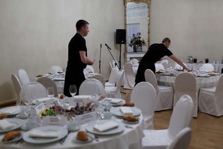 ministers: St. Petersburg, Russia - December 15, 2015: Staff preparing the business breakfast for ministers of culture from 40 countries during 4th St. Petersburg International Cultural Forum Editorial