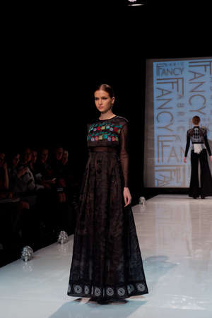 sums: St. Petersburg, Russia - December 5, 2015: Collection of fashion holding Fabric Fancy at the fashion show during St. Petersburg Fashion Week Overview. The event sums up the year