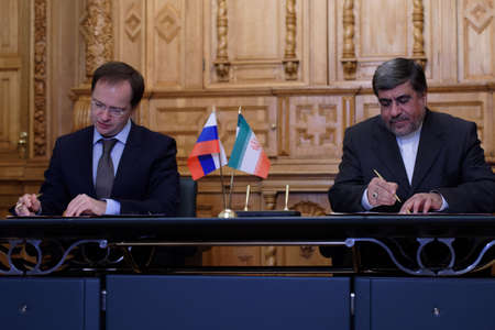 minister: St. Petersburg, Russia - December 15, 2015: Russian Minister of culture Vladimir Medinsky  and Iranian Minister of culture and Islamic Guidance Ali Jannati signs the memorandum on cooperation