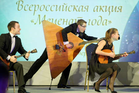 philanthropist: St. Petersburg, Russia - December 14, 2015: Group Balalaika from Syktyvkar preform during the award ceremony Philanthropist of the Year at the 4th St. Petersburg International Cultural Forum. Alisher Usmanov got the award Editorial