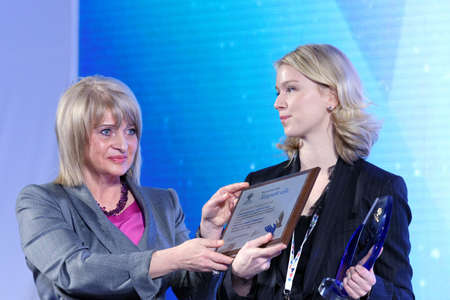 philanthropist: St. Petersburg, Russia - December 14, 2015: Deputy minister of culture Alla Manilova left presenting award Philanthropist of the Year at the 4th St. Petersburg International Cultural Forum. Alisher Usmanov got the award