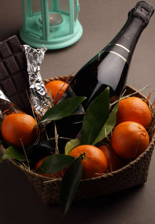 gift basket: Christmas gift basket with champagne, tangerines, and chocolate