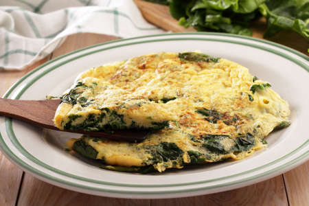 spinach: Spinach omelet on a rustic table Stock Photo