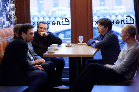 film director: St. Petersburg, Russia - December 16, 2015: Film director Alexey Uchitel center left and others in the cafe of the film studio Lendoc before the round table discussion during 4th St. Petersburg International Cultural Forum Editorial