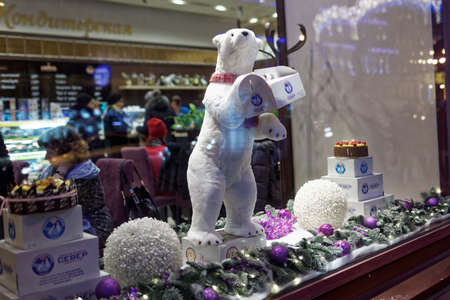 show window: St. Petersburg, Russia - December 27, 2015: Toy polar bear in the show window of the confectionery Sever. Founded in 1903 as a single bakery on Nevsky avenue, now the confectionery has more than 40 sweetshops in the city