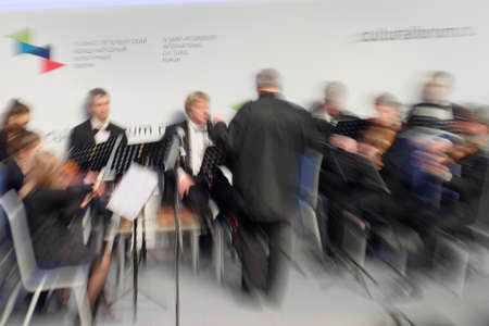 st  petersburg: St. Petersburg, Russia - December 16, 2015: Defocused image of the Symphony Orchestra of St. Petersburg perform at the creative meeting during the 4th St. Petersburg International Cultural Forum Editorial