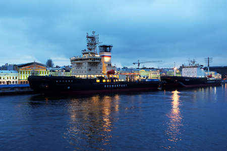 conduction: St. Petersburg, Russia - December 12, 2015: Icebreakers Moskva and Mudyug anchored at the English embankment. Moskva is designed for conduction of large tankers with width up to 50 m, and Mudyug performs guidance of ships to port