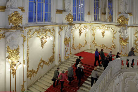 bartolomeo rastrelli: St. Petersburg, Russia - December 10, 2015: People admire the luxury interior of Winter Palace. Built in 1762 by design of Bartolomeo Francesco Rastrelli, now the palace is main building of the State Hermitage Museum