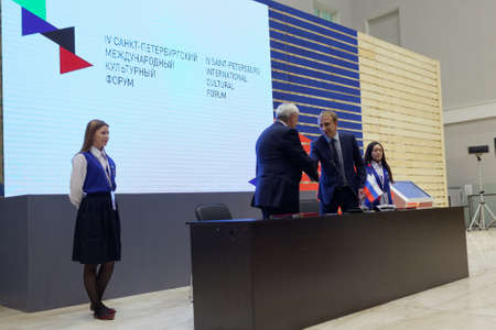 governor: St. Petersburg, Russia - December 16, 2015: Governor of St. Petersburg Georgy Poltavchenko left and Director of infrastructure of North-West branch of JSC MegaFon Alexey Titov sign the agreement on creation of Virtual Museum