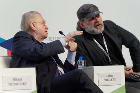 mikhail: St. Petersburg, Russia - December 16, 2015: Director the State Hermitage Museum Mikhail Piotrovsky left and theater director Andrey Moguchy during the final plenary session of 4th St. Petersburg International Cultural Forum
