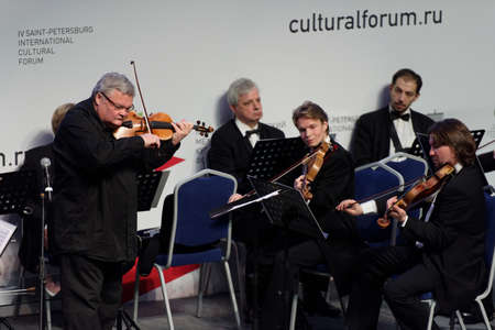 symphony orchestra: St. Petersburg, Russia - December 16, 2015: Violinist and conductor Sergey Stadler and the Symphony Orchestra of St. Petersburg play at the creative meeting during the 4th St. Petersburg International Cultural Forum Editorial