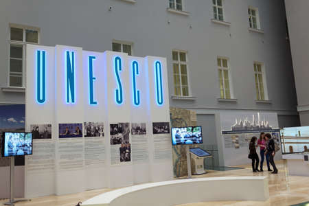 general cultural heritage: St. Petersburg, Russia - December 16, 2015: People in the exhibition dedicated to 25th anniversary of including the Russian sites in UNESCO World Heritage list during 4th St. Petersburg International Cultural Forum