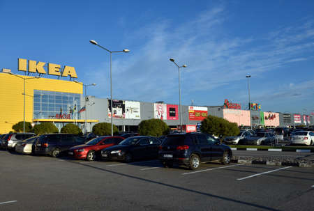 hypermarket: St. Petersburg, Russia - October 4, 2015: Cars on the parking lot against the shopping mall Mega Parnas. Opened in 2006, Mega Parnas has total area of 127,149 square meters and is one of the largest in the city