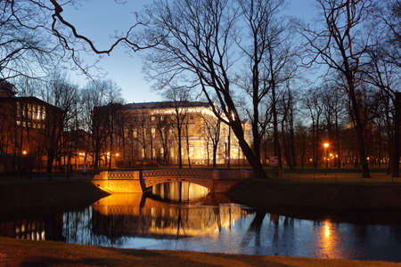 tourist attraction: St. Petersburg, Russia - December 8, 2015: Night view to the pond and Mikhailovsky Palace in the Mikhailovsky Garden. Built in 1819-1825 by design of Carlo Rossi, the palace houses the Russian Museum since 1895