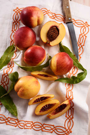 rustic: Nectarines on a rustic table Stock Photo