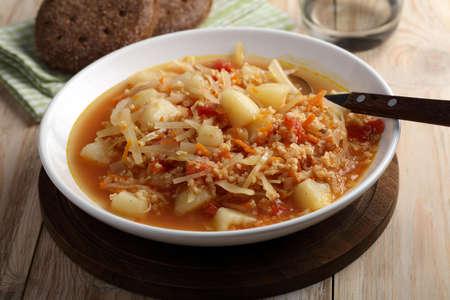 Traditional Polish soup kapusnyak on a rustic table
