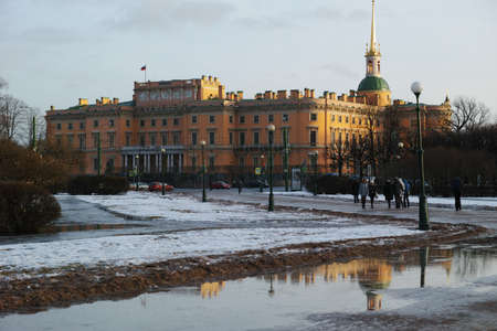 part of me: St. Petersburg, Russia - January 30, 2016: People at the field of Mars against the St. Michaels castle. Built in 1797-1801 as the residence of Emperor Paul I, now the castle is the part of Russian Museum