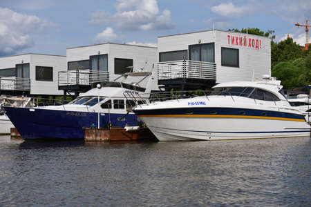 yacht club: Dolgoprudny, Moscow region, Russia - July 4, 2014: Boats moored in the yacht club Neptune. Founded in 1998, now the club have modern quay side for mooring over 100 vessels
