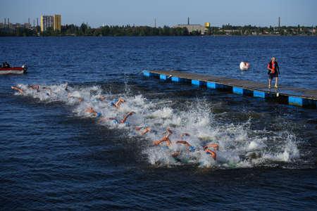 elites: Dnepropetrovsk, Ukraine - May 24, 2014: Start of ETU Sprint Triathlon European cup in the group Elite Men. Its the first time Triathlon European Cup take place in Ukraine
