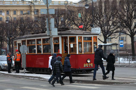 electric tram: St. Petersburg, Russia - February 6, 2016: Old styled tram at the crossroad of Kuybysheva street and Kamennoostrovsky avenue. The museum of urban electric transport organize trips in the retro styled trams of 1930s