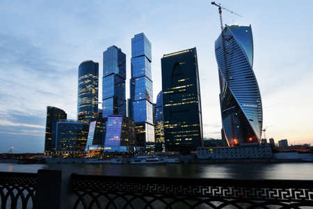 billions: Moscow, Russia - June 30, 2014: Moscow international business center Moscow City in evening. The construction started in 1995, costs for the present about 12 billions, and have to be finished in 2017
