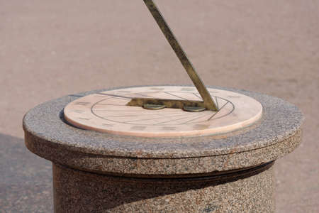 sundial: Marble sundial in a park