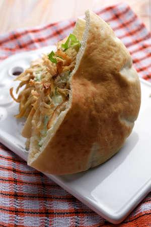 pita bread: Pita bread with chicken meat and tzatziki Stock Photo