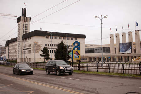 southeast europe: Plovdiv, Bulgaria - March 9, 2016: Traffic against the building of the International Fair Plovdiv. The Fairground is one of the largest exhibition venues in Southeast Europe