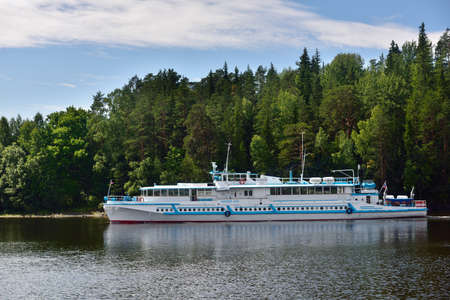 ferry boat: Valaam island, Russia - July 29, 2015: Ferry boat near the quay of Valaam monastery. About 100,000 pilgrims arrive in the Valaam monastery annually, 90,000 of which are tourists Editorial