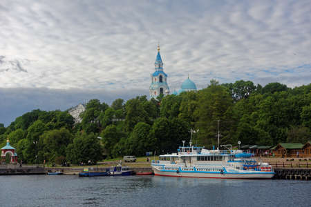 ferry boat: Valaam island, Russia - July 29, 2015: Ferry boat at the quay of Valaam monastery. About 100,000 pilgrims arrive in the Valaam monastery annually, 90,000 of which are tourists