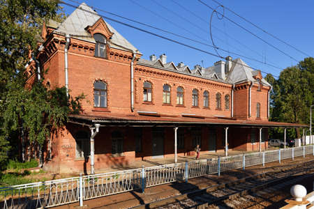 ferdinand: St. Petersburg, Russia - August 3, 2015: People at the Shuvalovo train station. Brick building was erected in 1908 by design of Bruno Ferdinand Granholm