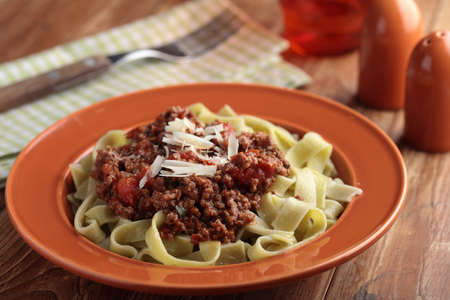 parmesan cheese: Pasta Bolognese with shredded Parmesan cheese Stock Photo
