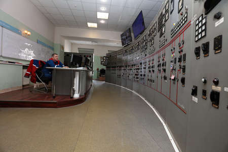 control center: Ivangorod, Leningrad oblast, Russia - March 29, 2016: Engineer in the control center of Narvskaya Hydroelectric Power Plant. Built in 1956 at the border between Russia and Estonia, it has nameplate capacity 125 MW Editorial
