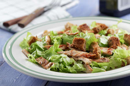 caesar salad: Caesar salad with lettuce, croutons, and turkey meat