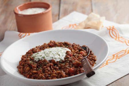 pita bread: Lentil stew with yogurt and pita bread Stock Photo