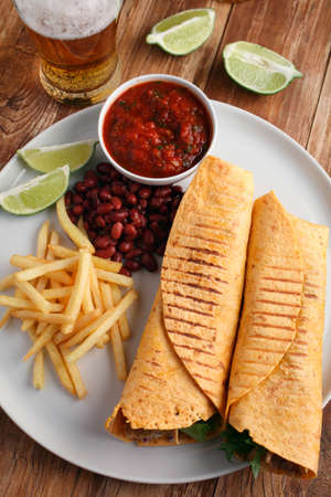 french bean: Chicken burritos with French fries, red bean, salsa sauce, and beer