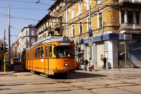 retro styled: Sofia, Bulgaria - March 05, 2016: Retro styled tram in the city center. The tramway system in Sofia was created in 1901, and now is the only tramway system in Bulgaria Editorial